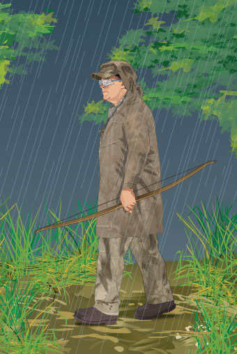 Bowhunter wearing rainwear