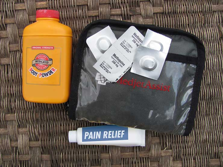 A first-aid kit with some of its contents on display