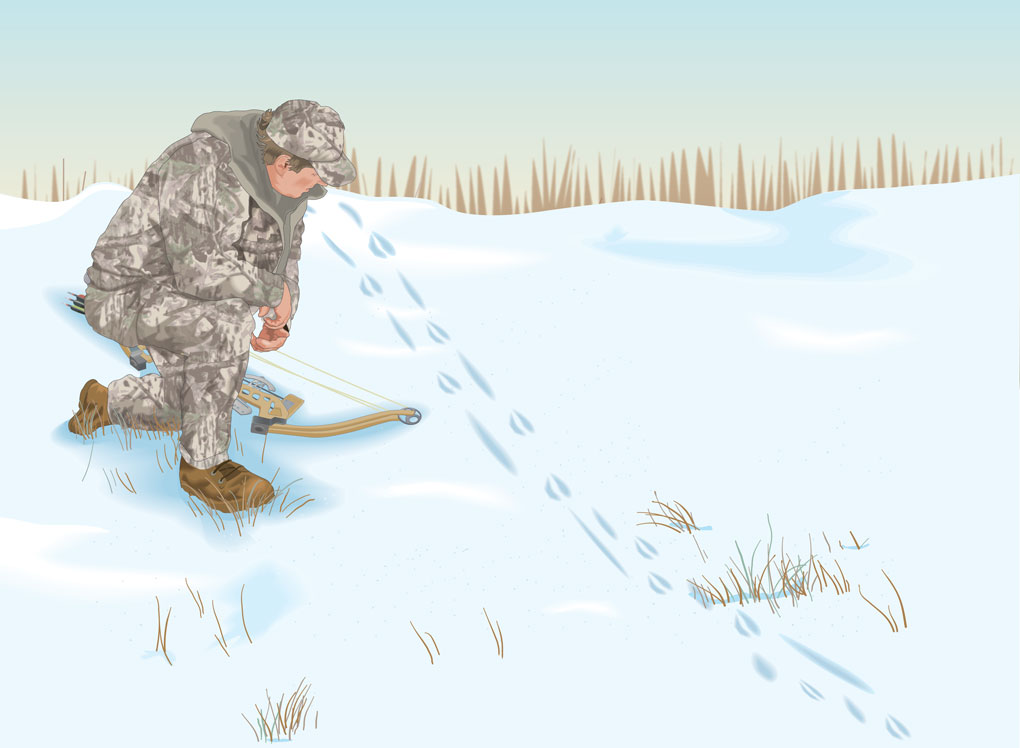 Bowhunter following tracks in the snow